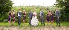 Saltwater farm vineyard wedding, wedding party bridesmaids groomsmen posed photo, grey suits plum purple grape dresses