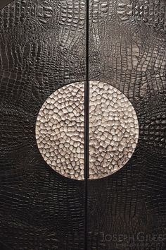 Joseph Giles Semi-Circle Hammered Stainless Steel Pad Handles on Leather Door