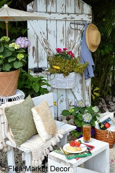 This old garden door creates a charming backdrop for this restful sitting area in the garden.