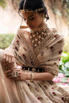 Gorgeous layered necklace with beige outfit. See more on wedmegood.com #wedmegood #indianwedding #indianbride #necklace #necklaceset #outfits