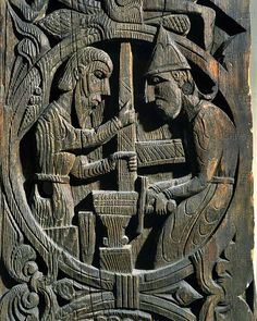 VIKING: The legend of Sigurd (Siegfried) from the Edda (collection of Norse mythological poems): Regin (Sigurd's foster father) and his helper forging the sword on the anvil. Wood panel from a church in Setesdal, Norway; 12th century