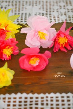 DIY Paper Flowers. So versatile.   Read more - http://www.stylemepretty.com/living/2013/06/21/diy-paper-flowers/