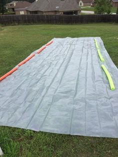 DIY slip-n-slide: calls for plastic sheeting, tent stakes, and pool noodles
