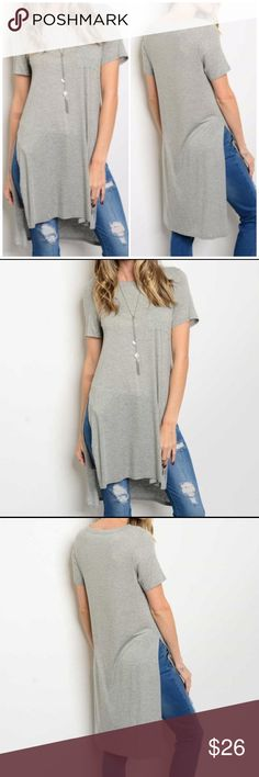 """Gray Side Slit Tunic Top Short sleeve round neck side slit jersey tunic top. 100% rayon. Available in small, medium and large. Measurements for small: Bust 32""""/ Length 39'. Bchic Tops Tunics"""