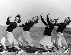 WAVES personnel serving as cheerleaders for the football team of Naval Air Station, Ottumwa, Iowa, United States, 21 Oct 1943. L to R: Virginia Gervais, Dorothy Nicoll, Mary Kneller, and Nancy Lanford