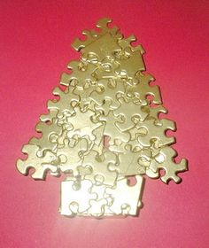 A tree out of puzzle pieces painted gold-no directions at link