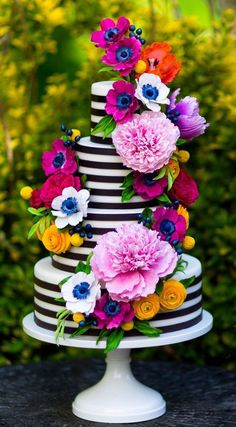 Love the stripes and vivid colors. I'd personally want less flowers than this pic shows, but, it is still an awesome cake :) Birthday Cake Awesome, Flower Birthday Cakes, Amazing Birthday Cakes, Colorful Birthday Cake, Colourful Cake, Flower Cakes, Awesome Cakes, Cute Cakes, Pretty Cakes