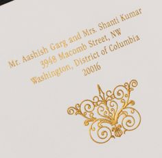 Our Embossed Scroll motif is shown in detail here, engraved in gold ink.