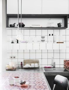 kitchen with red mosaic