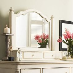 Scalloped mirror with a lift-top storage area and turned finials. Includes a power outlet and removable jewelry tray.Product: Dre...