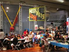 NeedleArts Zone at 2014 Detroit Maker Faire: Seventy volunteers in 17 hours taught at least 1,250 new needle artists across the various skills of knitting, crochet, needlepoint, cross-stitch, spinning, and our latest, tatting.