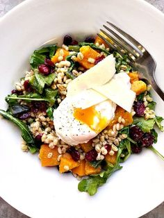 Roasted butternut squash and barley salad with dried cranberries, arugula and a poached egg #healthy #salad #vegetarian