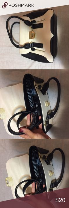 Satchel Used satchel bag. Includes side strap. Some discoloration shown in pictures above Charming Charlie Bags Satchels