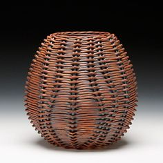 Weaved basket. This technique could be made into a necklace in a smaller scale as an accessory.
