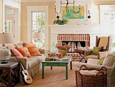 Like the neutral walls/couch/floor/chairs with pops of color in pillows, art, blankets, table