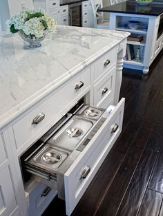 Kitchen island with hidden warming drawer. White kitchen island with polished nickel hardware and marble countertop. Wolf warming drawer in kitchen island disguised as kitchen drawer. New Kitchen, Kitchen Dining, Kitchen Decor, Kitchen Cabinets, Kitchen Island With Drawers, Island Kitchen, Kitchen White, Kitchen Ideas, Home Decoracion