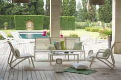 You could just opt for a simplistic set of stackable plastic outdoor furniture for… Outdoor Furniture Design, Garden Furniture, Dream House Pictures, Deck Flooring, Lounge, Swimming Pool Designs, Cool Pools, Sofa Set, Patio