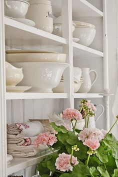 VIBEKE DESIGN: Dronninger og pasteller !  I love the open shelves of the hutch...It's so pretty set up with stoneware, linens and geraniums.