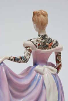 Porcelain figures covered in tattoos - would make an amazing tattooed bride wedding cake topper!
