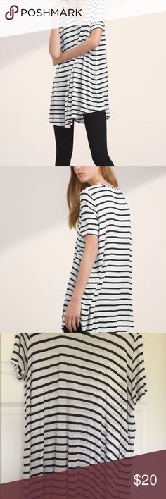 Stripe Tunic Bought from aritzia. Brand is Tahula. Some holes (shown in pictures) loose fit. I do not trade. Aritzia Tops Tunics