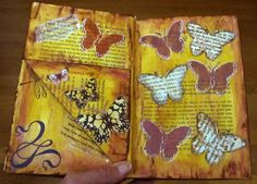 This page and the one before make the pocket that is on the left side. I realized afterwards there is a better way to make a pocket so I guess I'll have to make another altered book! I used the pages I ripped out to make die cuts and them embossed them. I used the negative space created by the cut out and inked directly to the page and outlined with the white pen. I also detail cut around a few purchased die cuts.