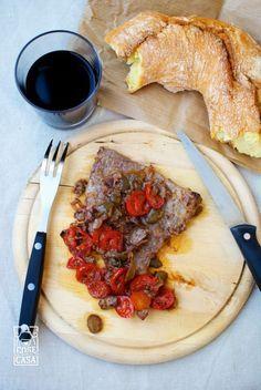 Fettine di vitello con olive e pomodorini
