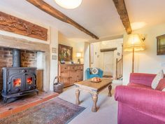The sitting room at Oak View Cottage oozes snuggly delight with soft sofas, a wood burner, chunky oak beams and character furnishings.