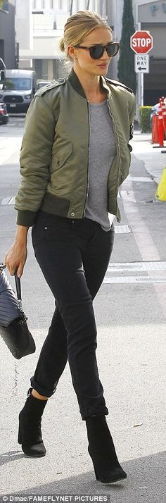 Casually cool: For her shopping expedition, the English star rocked a low key but stylish ensemble featuring a pair of tight black jeans, which she cuffed at the ankle, a grey T-shirt and an olive bomber jacket