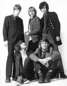 The Yardbirds....check it out. Jeff Beck staring up at Jimmy Page (far right)
