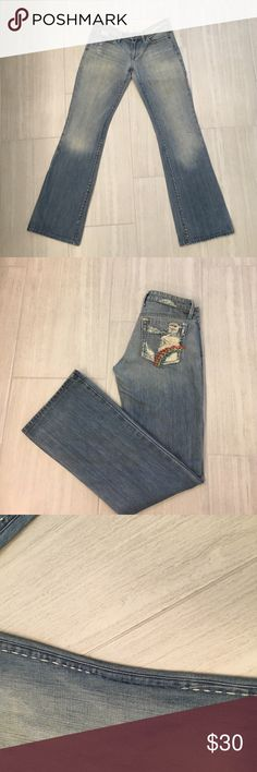 """Joes jeans Vintage series hen rainbow These are size 27 vintage series Hen Rainbow Joe's jeans. Some signs of wear as pictured. Some of the white stitching on the inside of the right leg has come up. Left leg has a light discoloration on the thigh and a small dark one near the foot. This all contributes to the overall look. Price reflects condition.                                                   15"""" waist, 7.5"""" rise, 32.5"""" inseam Joe's Jeans Jeans Flare & Wide Leg"""