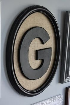 Paint An Old Picture Frame...cover the back with burlap and add a large painted wooden letter for huge wall impact! This would look awesome in a photo gallery or to spell out a surname.