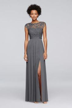 Gray long bridesmaid dress features a lace bodice, an illusion neckline with cap sleeves, a ribbon-defined waist, and a fluid mesh skirt with a slit.