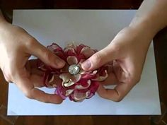 "Great YouTube video, ""Organza Flowers Tutorial Part 1 by Bethany Kartchner"" on making melted edge organza flowers from plain cirlces. *It's easier to go watch them on YouTube as they provide part 2 and 3 to click on, right when the first video ends. Enjoy!"