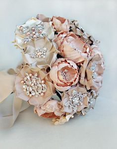 No luck getting flowers to bloom in winter? No problem. Use silk fabric blooms instead. These exquisite faux flowers feature sparkling heirloom jewels that last forever.   These gorgeous bouquets come from Emici Bridal.