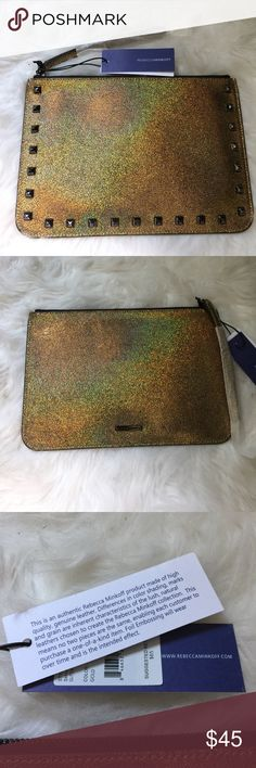 🆕 Rebecca Minkoff Kerry Pouch gold metallic Rebecca Minkoff pouch. Can be used as a clutch or wristlet. Gold metallic sparkle with studs on the front. No interior pockets. NWT and offers always welcome. Rebecca Minkoff Bags Clutches & Wristlets