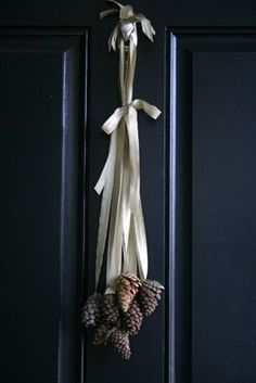 Pinecones and simple ribbon, front door holiday decoration