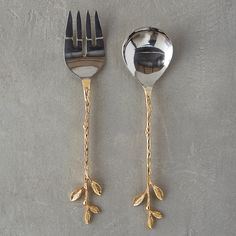"""This practical pair of stainless steel salad servers is paired with whimsical, leafy handles cast in brass.- Set of 2- Stainless steel, brass- Hand wash- Imported1.2""""H, 2.75""""W, 12""""L"""