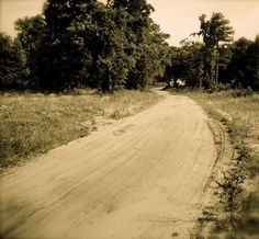 Drive down a dirt road towards the middle of nowhere.