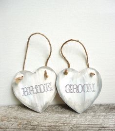 These sweet Bride and Groom wooden heart signs can be hung on the back of the newlywed's chairs at the reception or use them as photo props for the wedding photos. They are aged to perfection with distressing and twine is included for hanging // by DesignLifeStudio