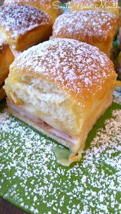 Monte Cristo sliders made with ham. turkey and cheese baked in a rich buttery topping dusted with powdered sugar.