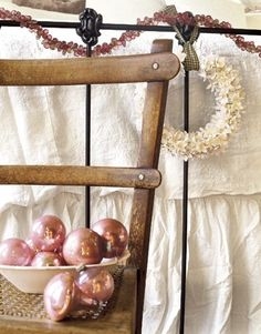 love the little wreath hanging on the iron bed...cute!