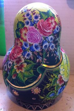 Matryoshka doll in floral dress by Nelly Marchenko