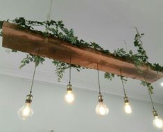 Recycled timber light feature with vintage looking LED lamps and greenery.