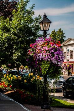view of down town Niagara on the Lake, showing an historic building and more trees and flowers