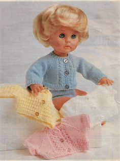 Cuddly Cardis, pattern from Woman's Value, April Knitting Dolls Clothes, Baby Doll Clothes, Knitted Dolls, Doll Clothes Patterns, Doll Patterns, Clothing Patterns, Baby Dolls, Best Baby Doll, Cloth Flowers