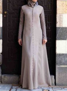 Embroidered Sleeves Gown Simply Taupe color You're going to fall head over heels in love with this delicately detailed gown. The intricate geometric floral motif on the sleeves, flattering princess seams, and flared skirt combine to create an elegant and exquisite look. The faux buttons add style and a picture-perfect finishing touch.