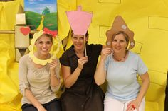 Photo booth for a Wizard of Oz birthday party. Background was yellow bulletin board paper. Cut outs were attached to dowel rods. Pictured are the Lion, Good Witch, and Scarecrow