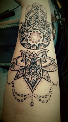 Hand of Fatima and a mandala lotus