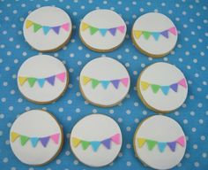 Simple, but completely darling rainbow bunting topped iced cookies. #decorated #cookies #food #rainbow #baking #dessert #bunting