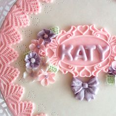 The gorgeous oval plaque mould, little flowers and domed alphabet by Katy Sue moulds was used on this design.